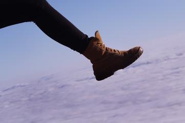 girl foot walking on clouds