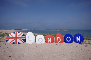 London city word with english flag on pebbles