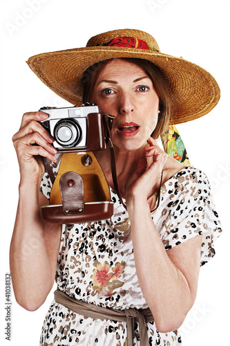 woman holding an old analog camera