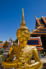 The golden Thai fairy bird on half human at Wat Phra Keaw, Thail