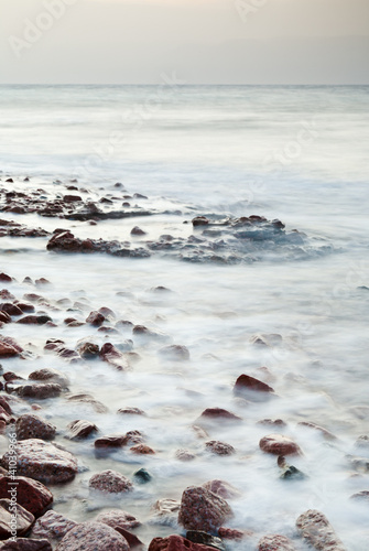 cobble stone beach of Read Sea on sunset