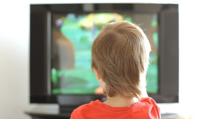 Little boy watching television
