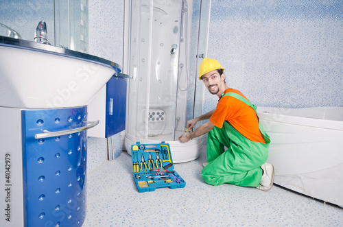 Plumber working in the bathroom