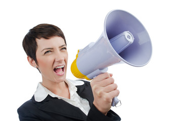 Young business lady screaming to loudspeaker