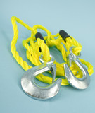 Yellow towing rope with metal hooks for car transportation