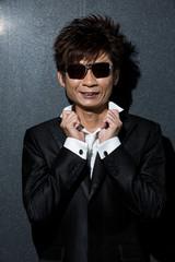 fashionable Asian man wearing stylish suit