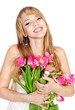 Picture of happy young blonde woman with colorful flowers