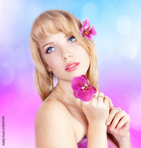 Beautiful girl with pink flowers