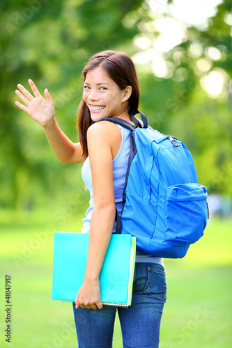 Woman student waving