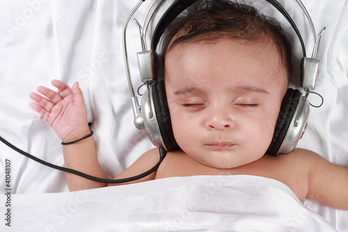2 Month old baby listening to music with headphones