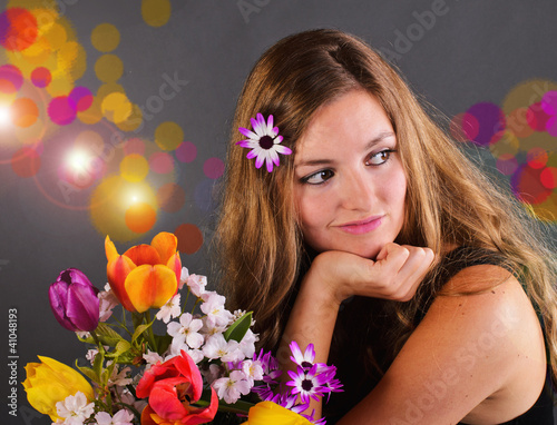 Springtime: young, pretty woman with colorful spring flowers