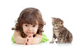 Funny child lying on floor. Scottish kitten sitting near girl.