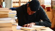 Boy writing and studiyng