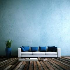Wohndesign - Sofa vor blauer Wand