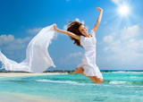 Fototapety Beautiful Girl With White Scarf Jumping on The Beach