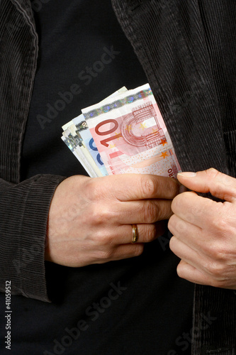 Man with euros in their pockets, close-up