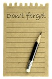 "Handwriting "" Don't forget "" on a natural note paper and pencil"