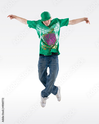 dancer jumps into the air and holds a pose