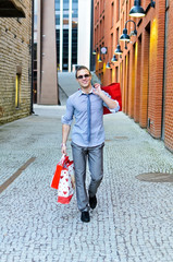 Portrait of handsome male with shopping bags