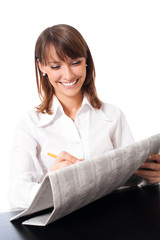 Happy woman with newspaper, over white