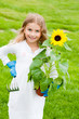 Gardening, lovely gardener with sunflower