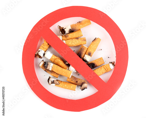 Cigarette butts with prohibition sign isolateed on white