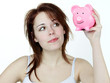 Young woman is happy to have bank notes in piggy bank