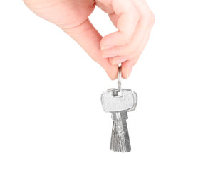 Keys in hand isolated on white