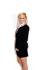 Smiling businesswoman in miniskirt suit