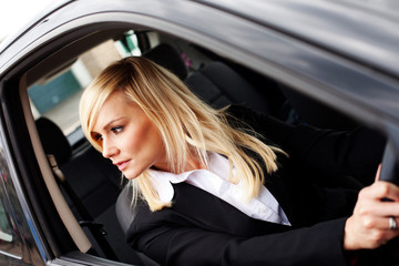 Attractive woman reversing a car
