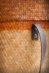 Steel botton and leather holder decorate on bamboo background