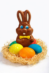 Five colored eggs and chocolate Easter bunny