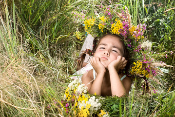 Girl lying on grass and smiling