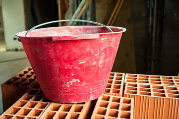 Bucket on hollow bricks