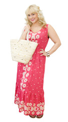 Beautiful blonde woman holding straw bag