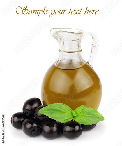 Loive oil with basil on white