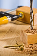 Drilling hole in a wooden plank.