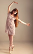 redhead girl in a pink dress imagine herself as a ballerina