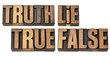truth, lie, true and false in wood type