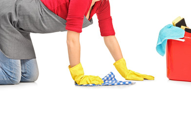 Female cleaner wiping down and bucket with cleaning supplies