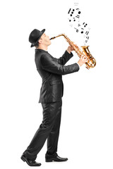 Male playing on saxophone and notes coming out