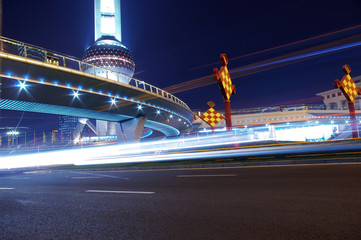the light trails on the modern building background in shanghai.