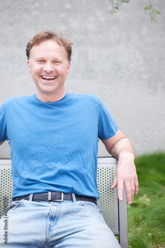 portrait of a man in a park