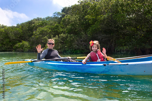 Young Girl Kayaking in tropical mangroves