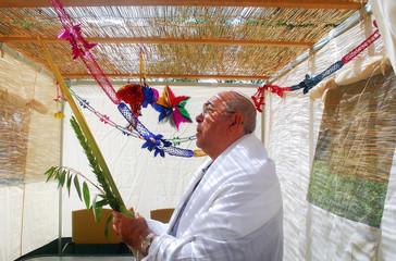 Praying in Sukkah for Jewish Holiday Sukkot
