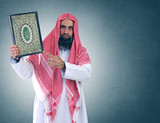 "Islamic Arabian Shiekh presenting the holy book "" Quran """