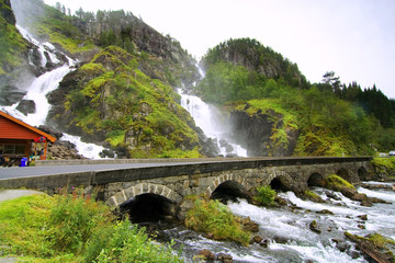 Beautiful waterfall scenery with old bridge