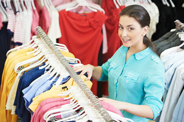 Young woman at shirts clothes shopping