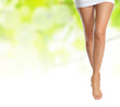 slender female legs making step over green