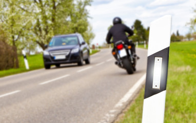 Motorbike and car - focus on foreground